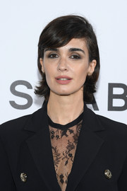Paz Vega wore her hair in a short style with a deep side part and flippy ends at the Elie Saab Spring 2019 show.