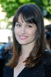 Maria Gillain showed off her shoulder length locks and blunt cut bangs while hitting the Elie Saab Couture show.