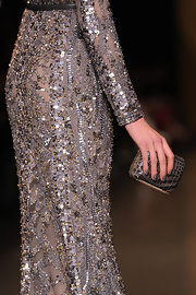 Karlie Kloss walked the Elie Saab runway carrying this ultra-chic gray crocodile clutch.