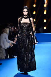 Kendall Jenner looked goth-glam in this sheer black strapless gown at the Elie Saab fashion show.