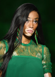 Winnie Harlow wore her hair down in a straight side-parted style while walking the Elie Saab runway.