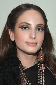 Alexa Ray Joel showed her funky style by matching her bright eyeshadow with her colorful outfit at the Elie Tahari runway show.
