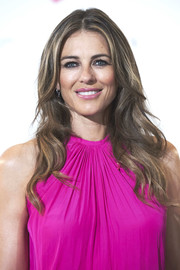 Elizabeth Hurley stuck to her signature center-parted waves when she attended the AECC Cancer Association meeting.
