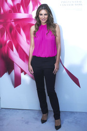 Elizabeth Hurley attended the AECC Cancer Association meeting wearing a stylish hot-pink halter top.