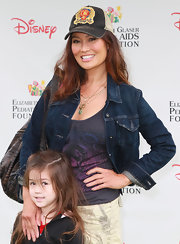 Tia Carrere was easy-breezy in a denim jacket and a baseball cap at the 'Time for Heroes' event.