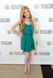 Katherine McNamara chose a teal ruffled dress for her fun and flirty look at the 'A Time For Heroes' charity event.