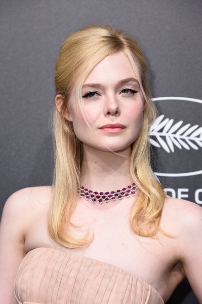 Elle Fanning Half Up Half Down [dinner - photocall,dinner photocall,hair,face,blond,hairstyle,eyebrow,beauty,chin,long hair,layered hair,lip,elle fanning,trophee,part,cannes,france,chopard,cannes international film festival]