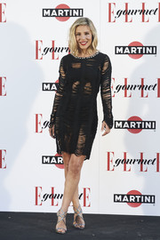 Elsa Pataky paired her sultry dress with silver Jimmy Choo Lance sandals.