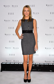Katie Cassidy hit the Elle magazine party wearing a chic day dress. She paired her look with platform pumps.