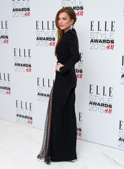 Lindsay Lohan smoldered at the Elle Style Awards in a black gown with a leg-baring net accent.