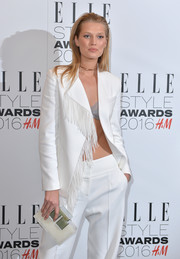 Toni Garrn paired an ultra-modern acrylic clutch with a fringed pantsuit for her Elle Style Awards look.