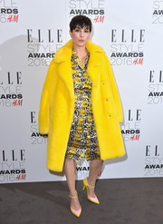 Noomi Rapace kept it vibrant all the way down to her pink and yellow Mary Jane pumps.