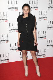 Sasha Lane opted for a modern and edgy black jacket and skirt set by Louis Vuitton when she attended the 2017 Elle Style Awards.