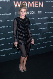 Elsa Pataky teamed her seductive dress with silver glitter pumps.