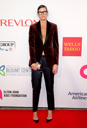 Jenna Lyons exposed a bit of cleavage in a red velvet jacket worn sans shirt underneath during the Enduring Vision benefit.