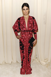 Nikki Reed looked exotic at the Elton John AIDS Foundation Oscar viewing party in a Naeem Khan print gown with a deep-V neckline.