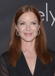 Marcia Cross opted for a no-frills center-parted hairstyle when she attended the Pink Party.