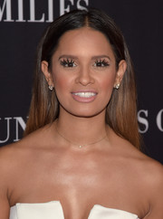 Rocsi Diaz attended the Pink Party wearing a simple center-parted 'do.