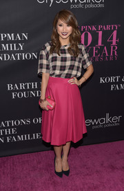 Brenda Song completed her cute outfit with a pink hard-case clutch.