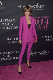 Lisa Rinna chose a pantsuit in a striking fuchsia hue for the Pink Party.