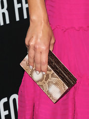 Giada De Laurentiis added exotic elegance to her pink frock with this chic croc-embellished clutch.
