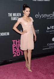 Aimee Garcia charmed in a pink cocktail dress with cap sleeves and a pleated skirt during the Pink Party.
