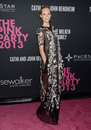 Poppy Delevingne flashed plenty of skin during the Pink Party in a sheer black Matthew Williamson evening dress featuring white floral embroidery.