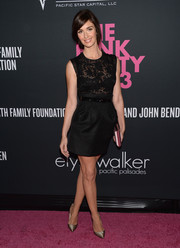 Paz Vega teamed a black mini skirt with a sheer lace top for a sexy-chic finish at the Pink Party.