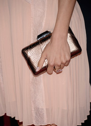 Aimee Garcia chose a bronze snakeskin clutch to complete her Pink Party look.
