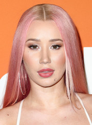 Iggy Azalea showed off sleek straight Barbie-pink tresses at the Ember launch.