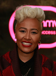 Emeli Sande looked flamboyant with her curly blonde fauxhawk while attending an album signing.