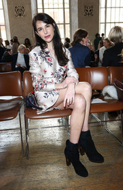 Caroline Sieber contrasted her girly frock with tough-chic black ankle boots by Celine.