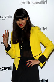 Jameela Jamil topped her sheer black blouse with this cool yellow tweed coat.