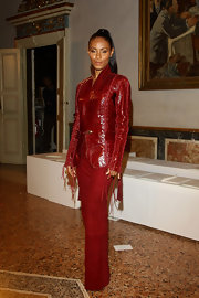 Jada showed off her fashionable ways in a red sequined blazer.