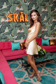 Emily Ratajkowski looked seductive in a pale-yellow cowl-neck mini dress by Saint Laurent while celebrating her 25th birthday.