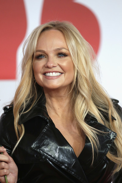 Emma Bunton Long Wavy Cut [hair,blond,hairstyle,beauty,layered hair,long hair,smile,brown hair,lip,leather,red carpet arrivals,emma bunton,brit awards,relation,the o2 arena,england,london]