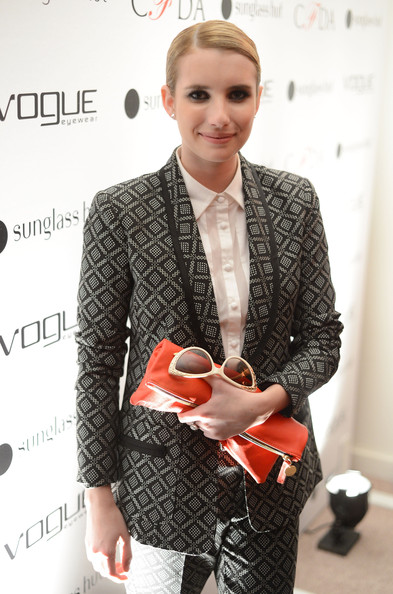 Emma Roberts Zip around clutch