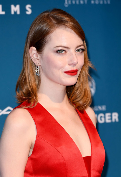Emma Stone Red Lipstick [hair,face,hairstyle,lip,beauty,chin,premiere,eyebrow,brown hair,long hair,red carpet arrivals,emma stone,london,england,old billingsgate,british independent film awards]