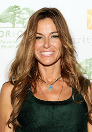 Kelly Bensimon wore her long locks in sexy feathered waves when she attended the Origins Smartyplants event.
