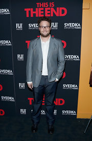 Seth Rogen dressed up a pair of jeans with a silver blazer.