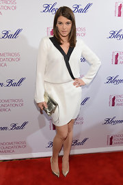 Gail Simmons opted for simple black and white with this white long-sleeved dress with black trim and cinched waist.