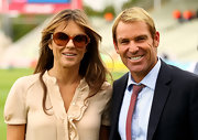 Shane Warne wore a thin dotted tie while at the England vs. India match.  He was accompanied by Liz Hurley.