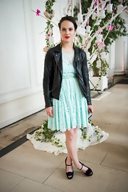 Jessica Brown-Findlay roughened up this dainty look with this leather jacket.