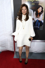 Catherine Keener opted for a conservative red carpet look with this long-sleeve white dress at the New York screening of 'Enough Said.'