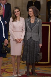 Princess Letizia kept it conservative yet stylish in a pale-pink skirt suit during an event honoring Enrique V. Iglesias.