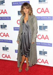 Halle Berry arrived for the Imagine benefit wearing a gray duster coat over a silk dress.