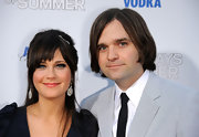 Zooey wears a bow-shaped and gemmed hairclip to add some sparkle to her look.