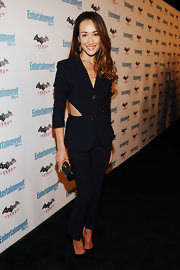 Maggie Q attended Comic-Con in a sleek black cutout suit. The cigarette pants and dramatic open back gave a modern and sexy feel to the classic pantsuit.