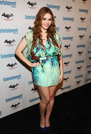 Holland Roden got colorful at Comic-Con in an abstract print dress and a pair of blue suede pumps. The heels added pop to her stylish look.