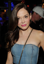 Rose McGowan opted for bright pink lips to pair with her summer-friendly strapless denim dress.